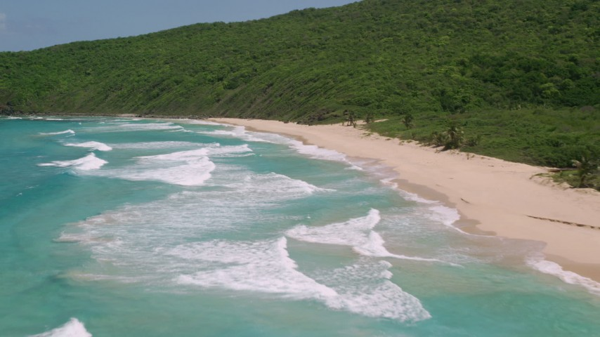 5k stock footage aerial video of Turquoise blue waters along a deserted Caribbean beach and lush vegetation, Culebra, Puerto Rico Aerial Stock Footage | AX102_118