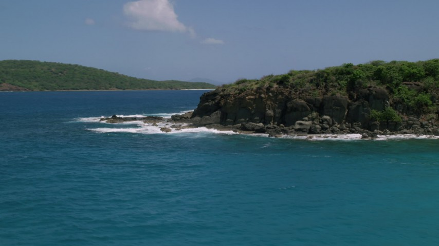 5k stock footage aerial video of Sapphire blue waters along a rugged coast, Culebra, Puerto Rico Aerial Stock Footage | AX102_126