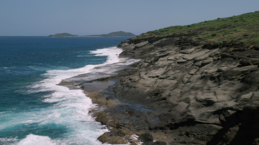 5k stock footage aerial video Flying along rugged coast and sapphire blue waters, Culebra, Puerto Rico  Aerial Stock Footage | AX102_127