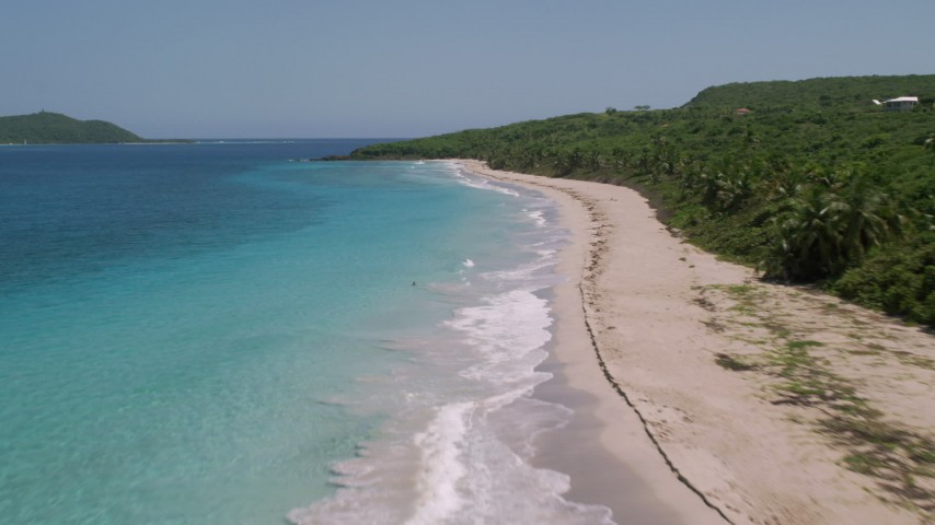 5k stock footage aerial video Flying low along a Caribbean beach and turquoise waters, Culebra, Puerto Rico Aerial Stock Footage | AX102_131