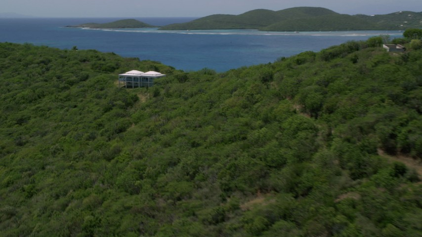 5k stock footage aerial video of a Hilltop home along sapphire blue waters, reveal coastal town, Culebra, Puerto Rico  Aerial Stock Footage | AX102_138