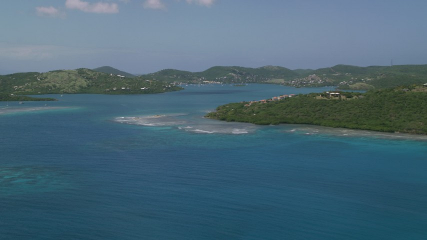 5k stock footage aerial video of Sapphire blue waters and a coastal town, Culebra, Puerto Rico  Aerial Stock Footage   AX102_139