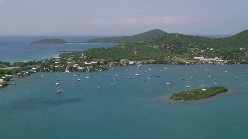 5k stock footage aerial video of Sail boats in sapphire blue water near a coastal town, Culebra, Puerto Rico  Aerial Stock Footage | AX102_142