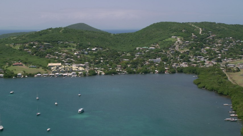 5k stock footage aerial video of a Coastal town along blue waters, Culebra, Puerto Rico  Aerial Stock Footage | AX102_143