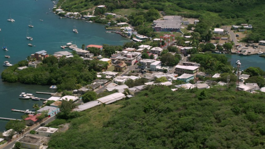 Coastal town along sapphire blue water, Culebra, Puerto Rico  Aerial Stock Footage | AX102_146
