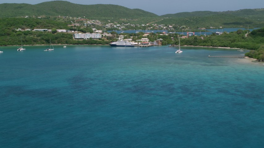5k stock footage aerial video of a Ferry in the sapphire blue waters near a coastal town, Culebra, Puerto Rico  Aerial Stock Footage | AX102_148