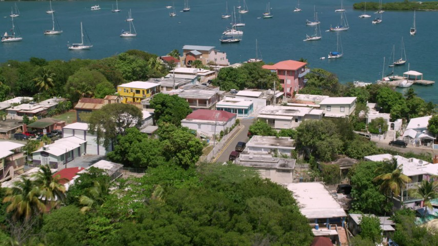 5k stock footage aerial video of a Coastal town along sapphire waters, Culebra, Puerto Rico  Aerial Stock Footage | AX102_152