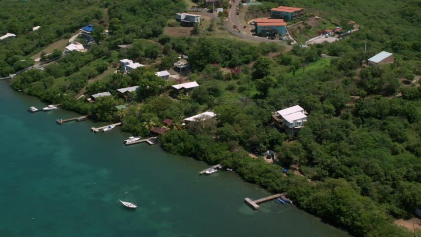 5k stock footage aerial video of Oceanfront homes along the coast and sapphire waters, Culebra, Puerto Rico Aerial Stock Footage | AX102_157