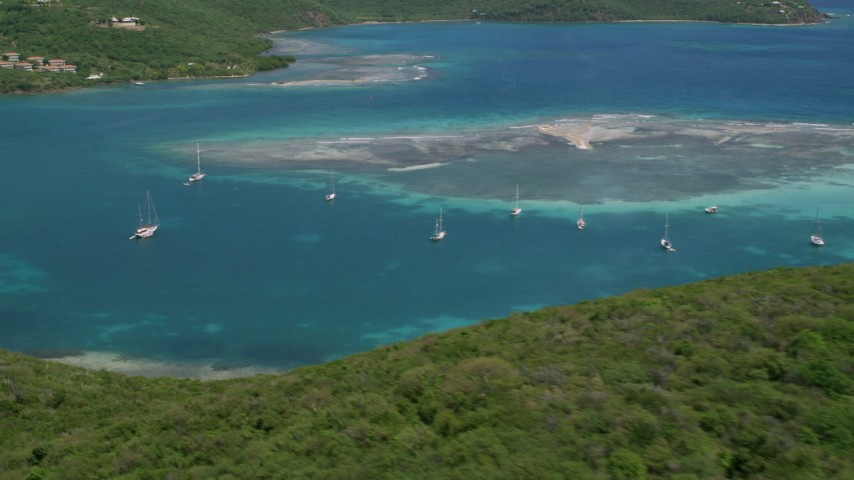 5k aerial video of Sailboats near a reef in sapphire blue waters, Culebra, Puerto Rico  Aerial Stock Footage | AX102_159