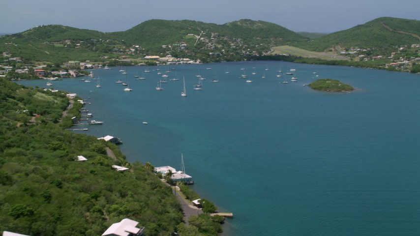 5K stock footage aerial video of sailboats in sapphire blue waters near the coast, Culebra, Puerto Rico Aerial Stock Footage | AX102_160