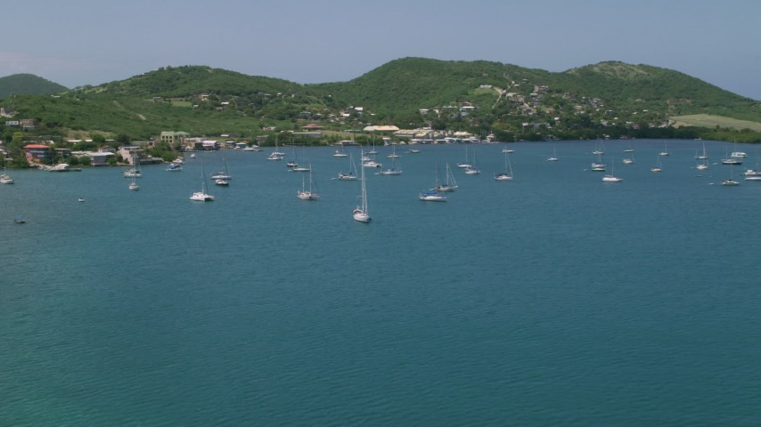 Sailboats in sapphire blue waters near a coastal town, Culebra, Puerto Rico  Aerial Stock Footage | AX102_161