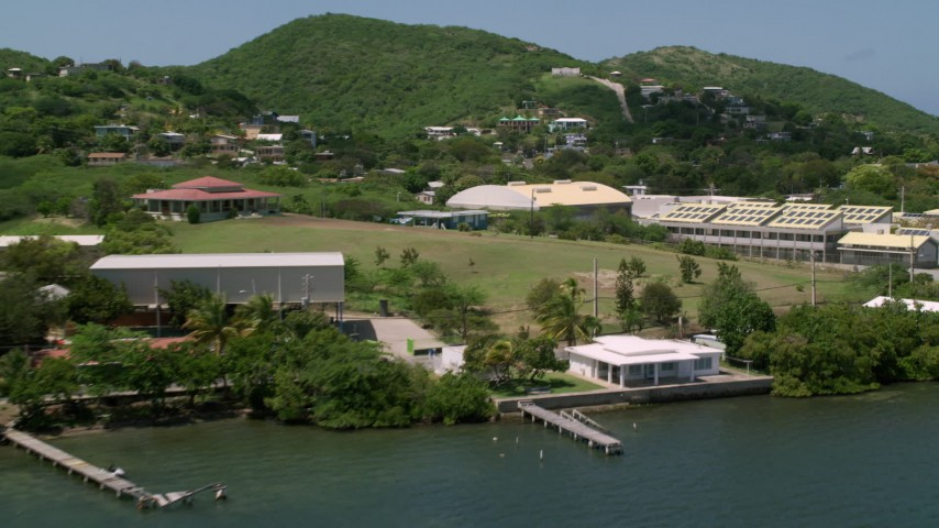 5k stock footage aerial video of a Factory and homes along the coast, Culebra, Puerto Rico  Aerial Stock Footage | AX102_163
