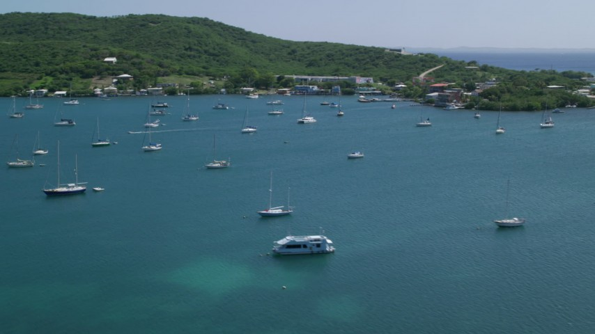 5k stock footage aerial video of Sailboats in blue waters along the coast, Culebra, Puerto Rico Aerial Stock Footage | AX102_167