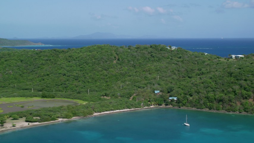 5k stock footage aerial video Flying over lush vegetation on a hillside toward crystal blue waters, Culebra, Puerto Rico Aerial Stock Footage | AX102_170