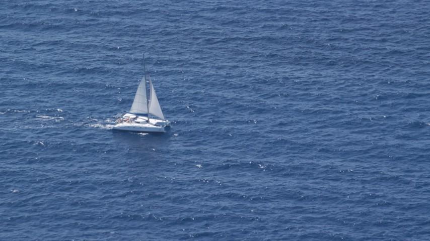 5k stock footage aerial video of a Catamaran on blue ocean waters, Atlantic Ocean  Aerial Stock Footage | AX102_194
