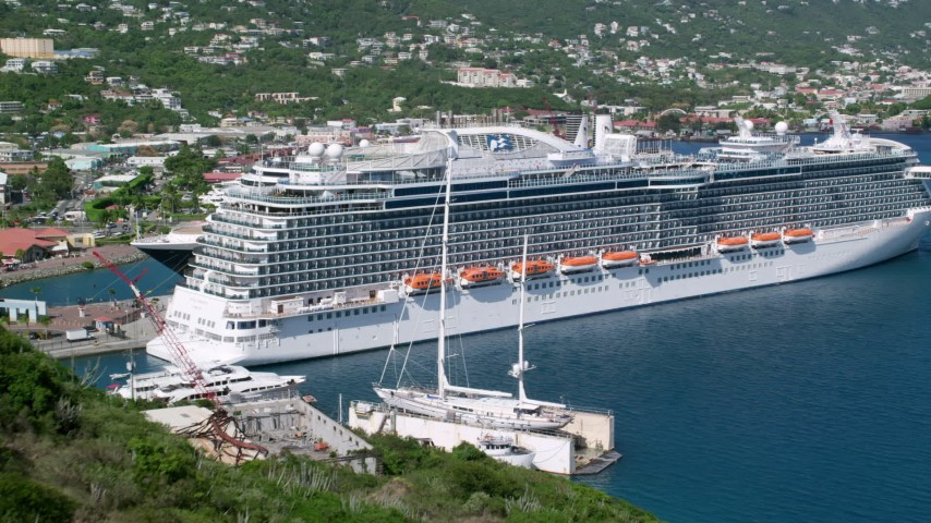 5k stock footage aerial video Reveal docked cruise ship in a coastal town, Charlotte Amalie, St. Thomas  Aerial Stock Footage | AX102_202