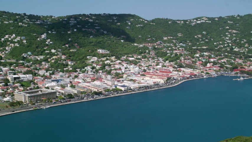 Coastal town on a hillside along sapphire waters, Charlotte Amalie, St. Thomas Aerial Stock Footage | AX102_207