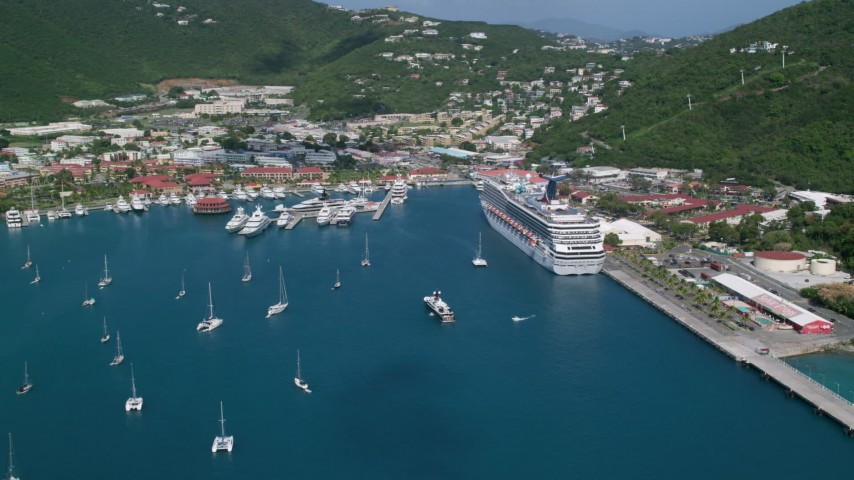 5k stock footage aerial video of a Cruise ship and yachts in sapphire waters along a coastal town, Charlotte Amalie, St. Thomas  Aerial Stock Footage | AX102_209