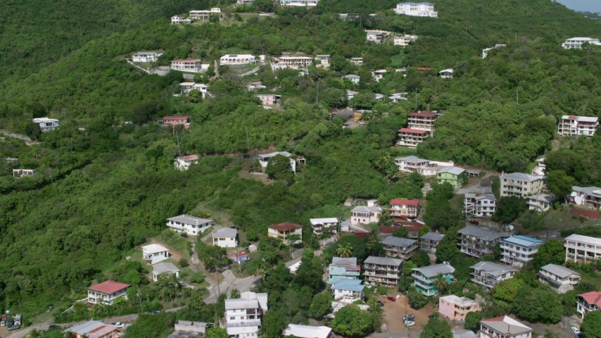 Upscale hillside homes nestled among trees, Charlotte Amalie, St. Thomas  Aerial Stock Footage | AX102_212