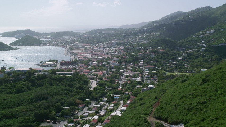 5k stock footage aerial video of a Coastal town seen from the hills toward the ocean, Charlotte Amalie, St. Thomas  Aerial Stock Footage AX102_214