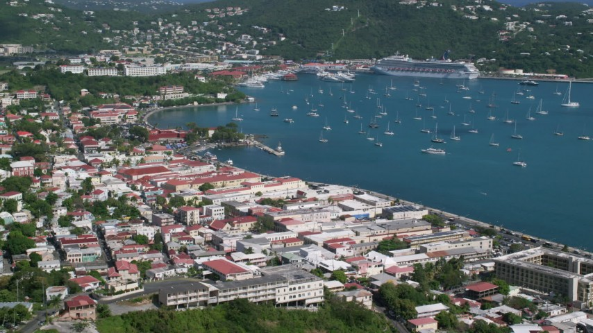 5k stock footage aerial video of a Coastal town and sapphire waters with sailboats, Charlotte Amalie, St Thomas  Aerial Stock Footage | AX102_220