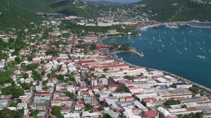 5k stock footage aerial video of a Coastal town along sapphire waters, Charlotte Amalie, St Thomas Aerial Stock Footage | AX102_221