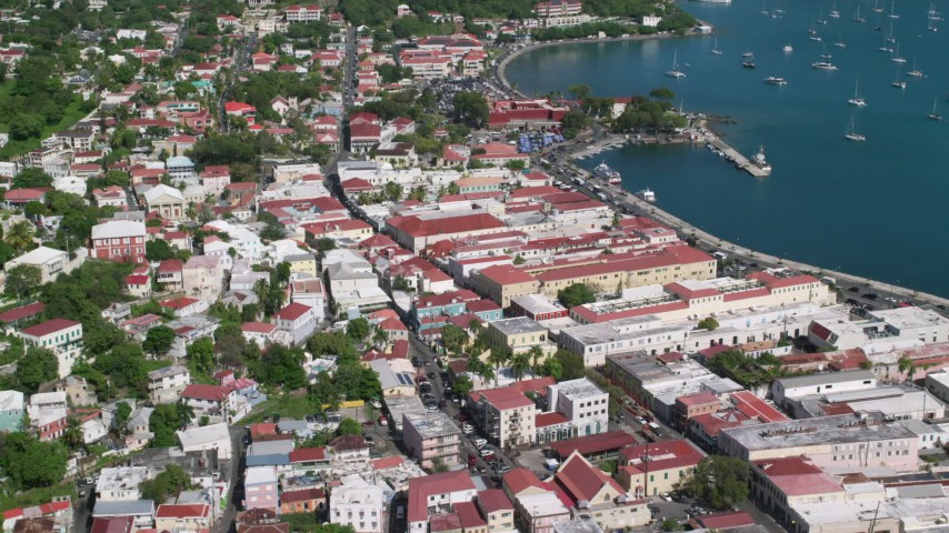 5k stock footage aerial video of a Coastal buildings along sapphire blue waters, Charlotte Amalie, St Thomas  Aerial Stock Footage | AX102_222