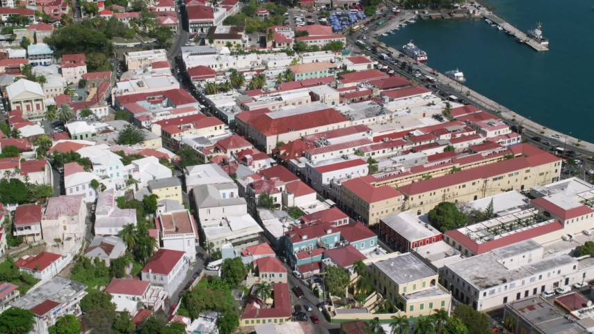 Coastal buildings along sapphire blue waters, Charlotte Amalie, St Thomas  Aerial Stock Footage | AX102_223