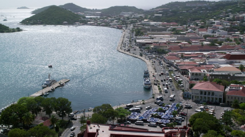 5k aerial video of a Coastal town against the hills along blue waters, Charlotte Amalie, St Thomas  Aerial Stock Footage | AX102_225