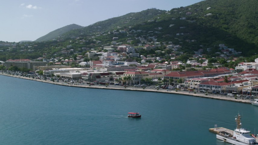 Coastal town against the hills along blue waters, Charlotte Amalie, St Thomas  Aerial Stock Footage | AX102_226