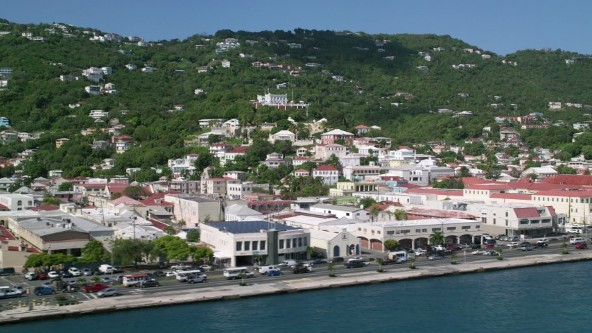 Buildings along the shore of a coastal town, Charlotte Amalie, St Thomas Aerial Stock Footage | AX102_229