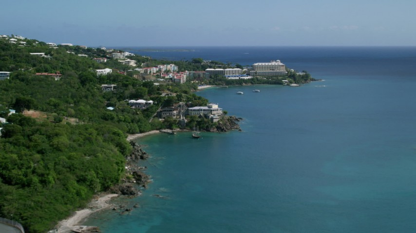 5k aerial video of Marriott's Frenchman's Cove on sapphire blue waters,  St Thomas  Aerial Stock Footage | AX102_231