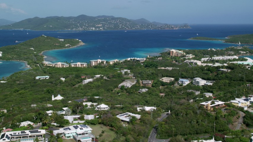 5k stock footage aerial video of The Ritz-Carlton resort along turquoise waters, St Thomas Aerial Stock Footage | AX102_242