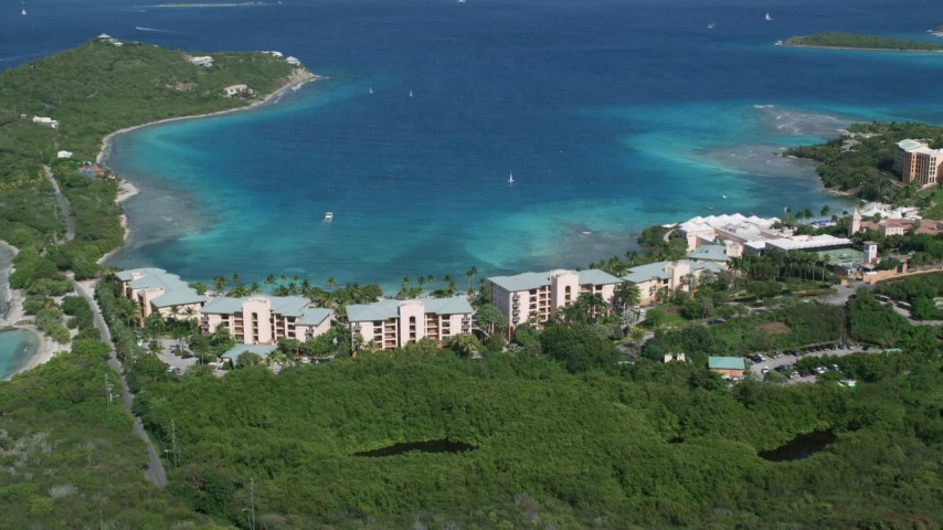 5k aerial video of The Ritz-Carlton resort along turquoise blue waters, St Thomas, US Virgin Islands  Aerial Stock Footage AX102_243