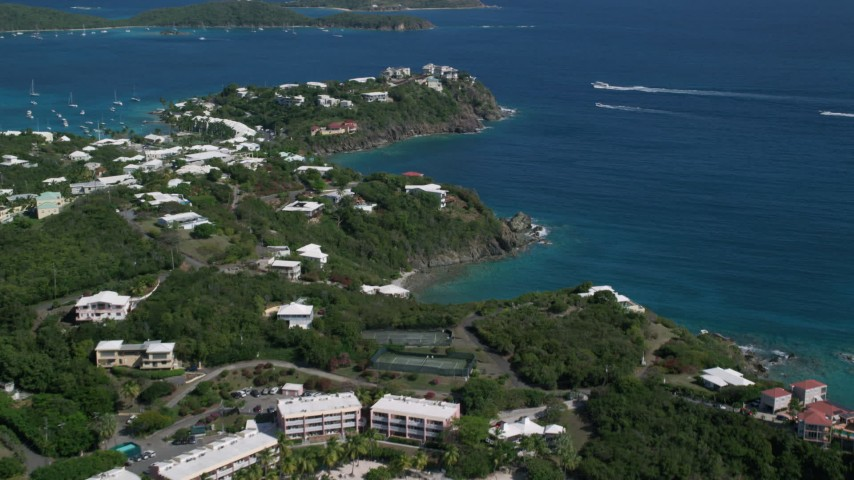 5k aerial video of Oceanfront homes on sapphire blue waters, East End, St Thomas  Aerial Stock Footage | AX102_246