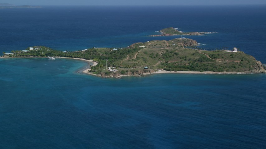 5k aerial video of Little St James Island in sapphire blue waters, St Thomas, Virgin Islands Aerial Stock Footage | AX102_249