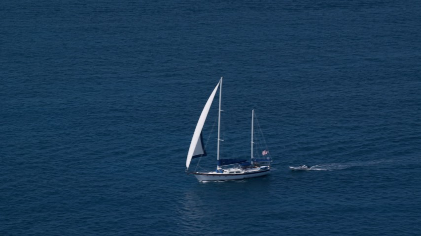 5k stock footage aerial video of a Sailboat in sapphire blue waters, St Thomas, USVI  Aerial Stock Footage | AX102_255