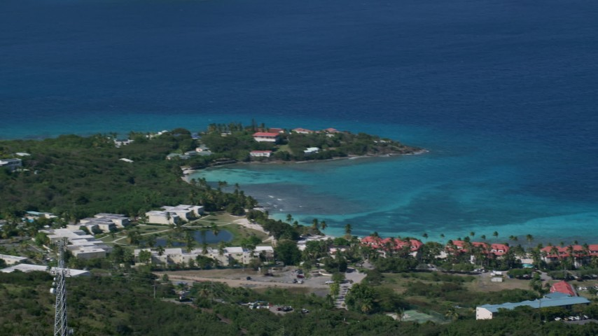 5k stock footage aerial video of Condominiums along sapphire blue Caribbean waters, East End, St Thomas Aerial Stock Footage | AX102_257