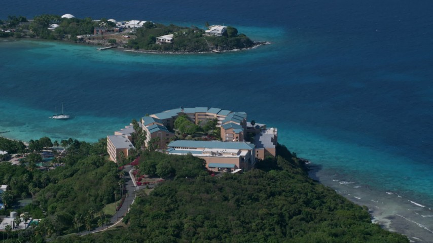 5k stock footage aerial video of Sugar Bay Resort and Spa along turquoise blue waters, St Thomas Aerial Stock Footage | AX102_258
