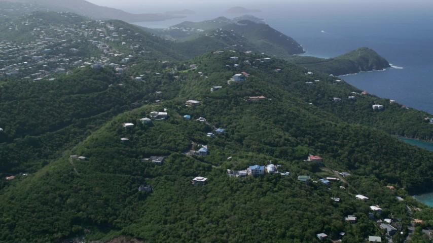 5k stock footage aerial video of Hilltop homes over looking the blue ocean waters, East End, St Thomas  Aerial Stock Footage | AX102_259