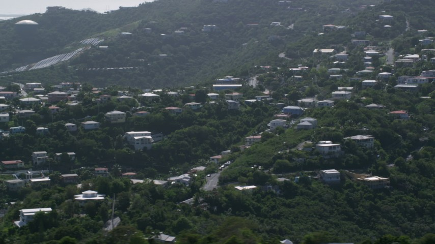 5k stock footage aerial video of Hilltop homes among trees, East End, St Thomas  Aerial Stock Footage AX102_260 | Axiom Images