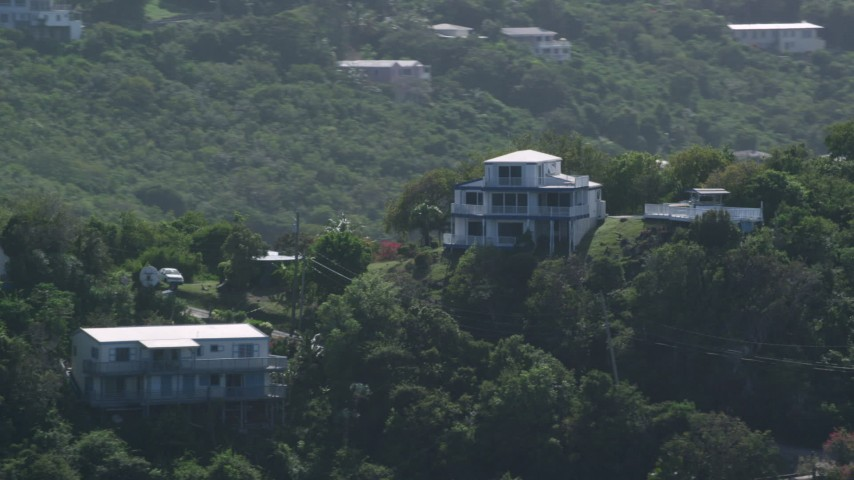5k stock footage aerial video of a Hilltop home surrounded by trees, East End, St Thomas Aerial Stock Footage | AX102_261