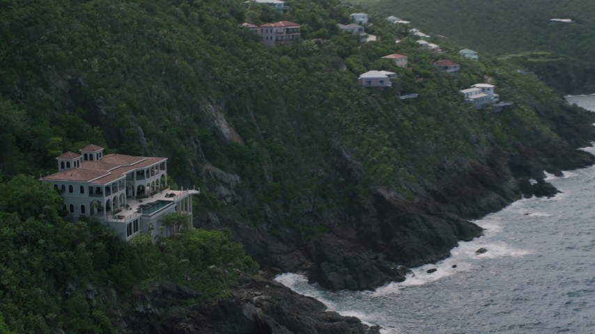 5k stock footage aerial video of an Oceanfront mansion on a cliff, Northside, St Thomas  Aerial Stock Footage | AX102_266