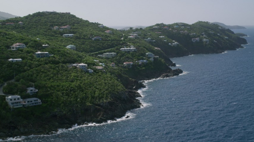 5k stock footage aerial video of an Oceanfront hillside mansions, Northside, St Thomas  Aerial Stock Footage | AX102_267