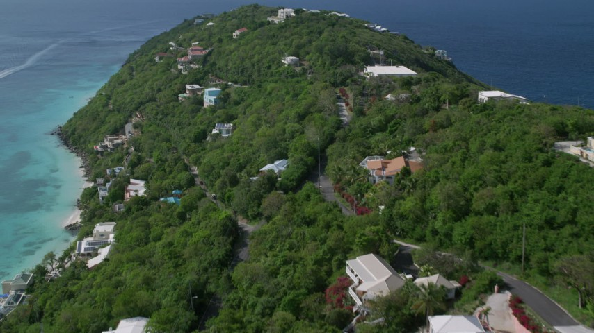 5k aerial video of Hillside homes along the turquoise blue Caribbean waters, Magens Bay, St Thomas Aerial Stock Footage | AX102_275