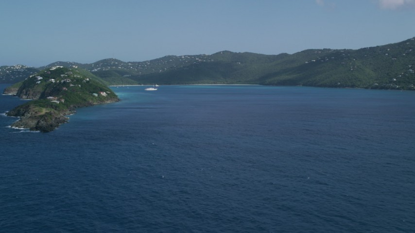5k aerial video Approaching Picara Point, leading to crystal blue water in Magens Bay, St Thomas, USVI Aerial Stock Footage | AX102_279
