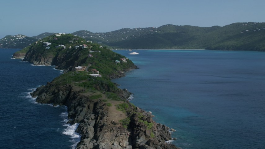 5k aerial video of Hillside oceanfront homes along sapphire blue Caribbean waters, Magens Bay, St Thomas  Aerial Stock Footage | AX102_280