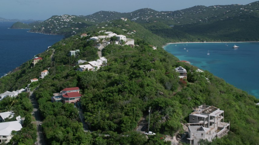 5k aerial video of Oceanfront hillside homes along sapphire blue Caribbean waters, Magens Bay, St Thomas  Aerial Stock Footage | AX102_282