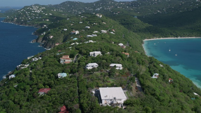 5k stock footage aerial video of Hilltop oceanfront homes along sapphire blue Caribbean waters, Magens Bay, St Thomas  Aerial Stock Footage | AX102_283