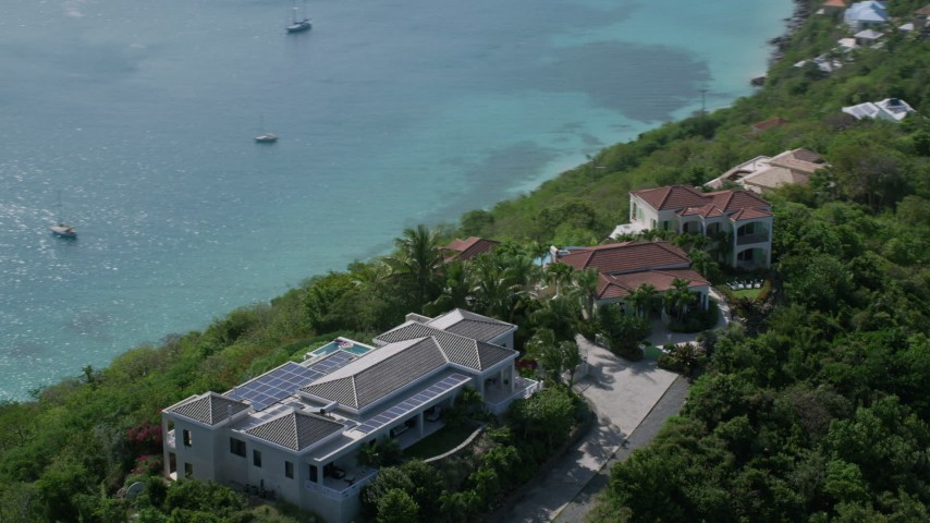5k aerial video of Hilltop mansions overlooking turquoise blue Caribbean waters, Magens Bay, St Thomas Aerial Stock Footage | AX102_287